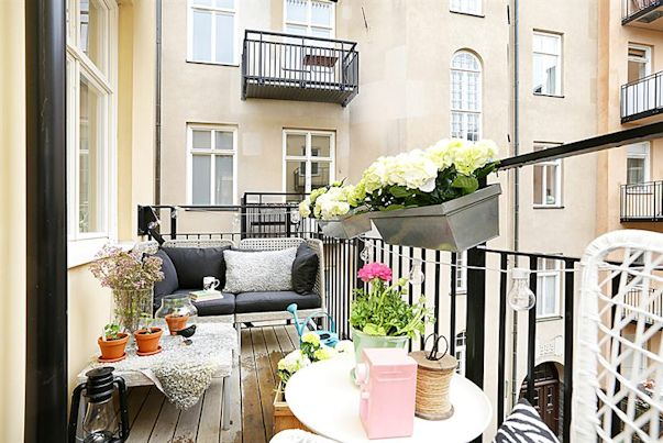 Decotour un monoambiente con detalles femeninos decocasa for Decoracion balcon departamento